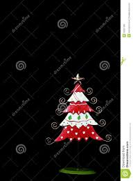 red and white tin christmas tree against black stock photo