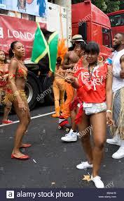 Dancing Flags Girls Dancing At The Notting Hill Carnival Waving Jamaican Flag