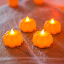 Set Of Four Pumpkin Led Tea Lights Tomb Sweet Tomb