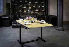 table converts to shelf space saving table converts into shelf with all the stuff on top