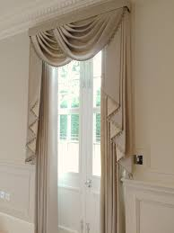 we created these stunning luxurious window treatments including matching tails with a slightly contrasting lining and bauble trim and beautiful plain curtains to add elegance to the room in the georgian home