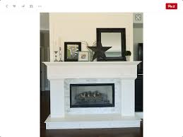 white fireplace with black accent pieces fireplace refinishing