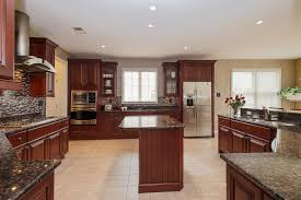 traditional kitchen with limestone tile floors breakfast bar in