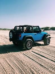 jeep wrangler beach sunset post wander dust