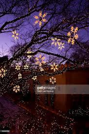 christmas decorations hang along canyon road in santa fe new