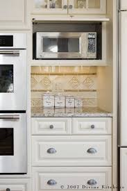 kitchen cabinet with microwave shelf hide the ugly microwave in a cabinet and save counter space home