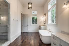 tub with vintage deck mount tub filler transitional bathroom