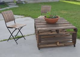 diy outdoor wood coffee table using reclaimed wood and wheels with