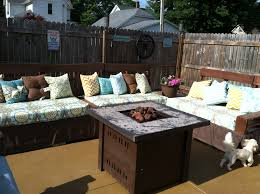our pallet sectional with arm rest and an table on side