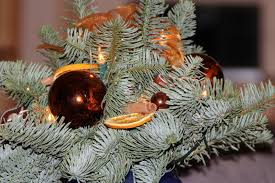 green plastic artificial tree leaves and gold and