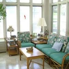 sunroom furniture with metal chairs and wicker couch and chair and