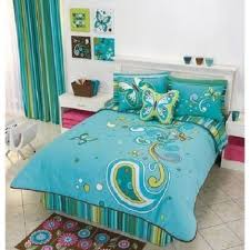 green and blue bedroom blue bed sheet with butterflies picture on the cream tile floor