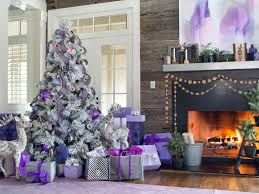 purple snow with red ribbon on christmas tree in the fireplace