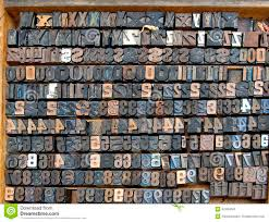 wooden box with old printing letters and numbers stock photo