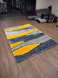 rectangle yellow and grey fur rug in accent applied on brown wood