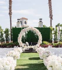 flower arch picture of lush white flower aisle decor and a circle white flower