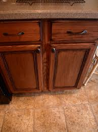 How To Paint Stained Kitchen Cabinets Painting Over Stained Cabinets In The Kitchen Edgarpoe Net