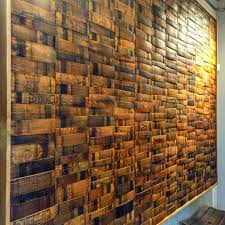 wine or whiskey barrel stave wall paneling can make a bold