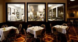 open kitchen dining room interior of luke restaurant new orleans