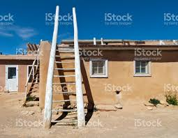 acoma pueblo street with adobe houses and ceremonial kiva ladders