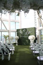 wedding altar backdrop green flower wall event decor hire chair covers and centrepieces