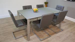 the ancona extending dining table has a matt glass table top and