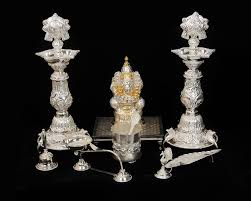silver items pooja set with vinaygar idol gold silver brass