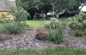 landscape hack create dry creek beds with river rock roundtree