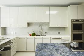 using high gloss paint on kitchen cabinets high gloss painted cabinets at perimeter and metalized white