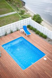 above ground pool deck kits pool traditional with beach house deck