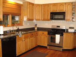 Kitchen Colors With Oak Cabinets And Black Countertops by Oak Wood Espresso Shaker Door Cabinets Kitchen Ideas Backsplash