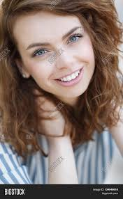 beautiful with grey eyes and long curly red hair a nice smile