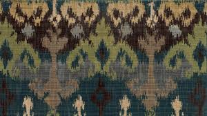 blue and green ikat pattern wool area rug woodwaves