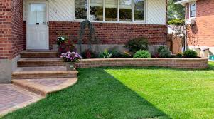 attractive mordern front yard wall designs with white and brown