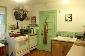 green wooden door and cream wall theme connected by white stove on
