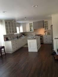 Wood Flooring In Kitchen by Floor Transition Laminate To Herringbone Tile Pattern Model
