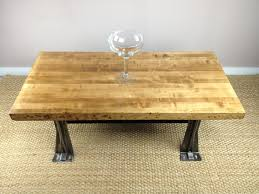 low coffee table with butcher block top and unique metal legs of