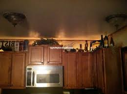 above kitchen cabinet decorating ideas for what to put above kitchen cabinets decor kitchen