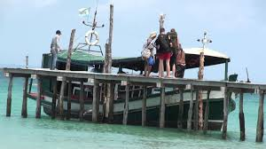 ferry boat departing sandy beach bungalows koh rong samloem