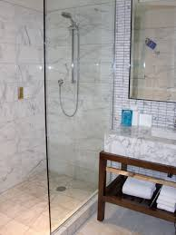 Showers In Small Bathrooms Brown Wooden Vanity With Shelf And White Marble Sink Beside Glass