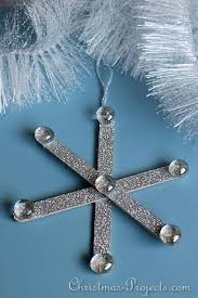 glitter popsicle stick or craft stick snowflake ornaments