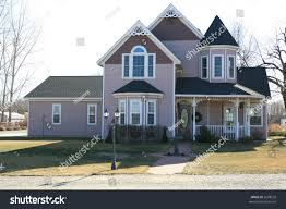 mauve colored victorian style country house stock photo 2608558
