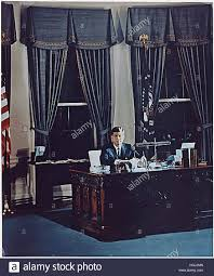 portrait of united states president john f kennedy at his desk in