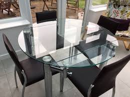 round glass extendable dining table 115cm with 4 faux leather