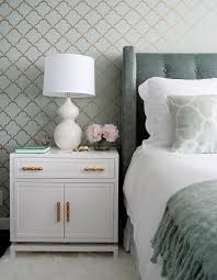 white nightstand with gold bamboo pulls transitional bedroom