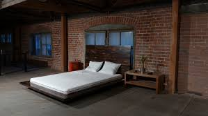 garage conversion into bedroom with red brick wall and low profile garage conversion into bedroom with red brick wall and low profile bed with oak wooden base and high headboard ideas