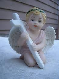 cherub angel cross figurine porcelain 1980s four seasons home