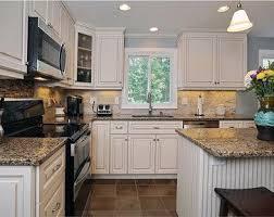 Black Appliances Kitchen Design - kitchen white cabinets amp black appliances design ideas