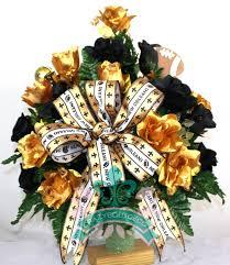 flower arrangement new orleans saints fan vase cemetery flower arrangement