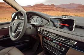 bmw dashboard at night 2014 bmw x5 first look truck trend